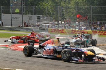 © Octane Photographic Ltd. 2011. Formula 1 World Championship – Italy – Monza – 11th September 2011 Sebastian Vettel (Red Bull) leads Fernando Alonso's Ferrari whilst Michael Schumacher (Mercedes) runs wide whilst trying to keep back Lewis Hamilton in his McLaren – Race – Digital Ref :  0177CB7D8017