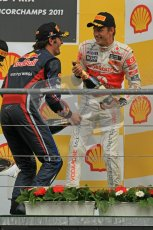 © Octane Photographic Ltd. 2011. Formula One Belgian GP – Spa – Sunday 28th August 2011 – Jenson Button and Mark webber ready to spray the Champagne on the podium. Digital Reference : 0169cb1d1096