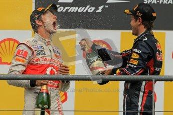 © Octane Photographic Ltd. 2011. Formula One Belgian GP – Spa – Sunday 28th August 2011 – Sebastian Vettel sprays Jenson Button on the podium. Digital Reference : 0169cb1d1146