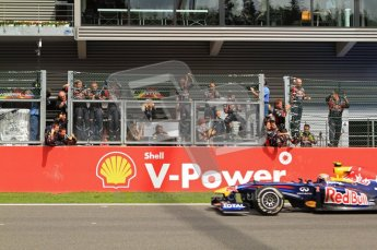 © Octane Photographic Ltd. 2011. Formula One Belgian GP – Spa – Sunday 28th August 2011 – Race. The Red Bull Racing mechanics celebrate as Mark Webber passes them after coming 3rd. Digital Reference : 0168cb7d0989