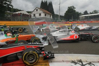 © Octane Photographic Ltd. 2011. Formula One Belgian GP – Spa – Sunday 28th August 2011 – Race. Paul di Resta in his Force India tags the back of Jenson Button's McLaren at the 1st corner on the opening lap. Digital Reference : 0168lw7d8529