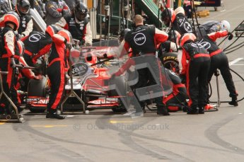 © Octane Photographic Ltd. 2011. Formula One Belgian GP – Spa – Sunday 28th August 2011 – Race. The Virgin Racing pit crew leap into action. Digital Reference : 0168lw7d9361