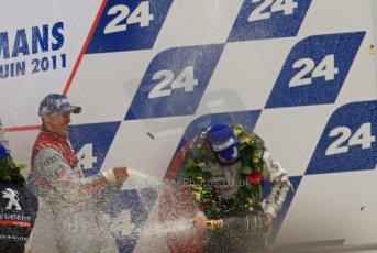 © Octane Photographic 2011. Le Mans finish line and podium - Sunday 11th June 2011. La Sarthe, France. Digital Ref : 0263lw7d8332