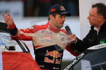 © North One Sport Ltd 2011 / Octane Photographic Ltd 2011. 13th November 2011 Wales Rally GB, Podium. Newly Crowned 8 times champions Sebastien Loeb being interviewed on the podium. Digital Ref : 0201cb1d9844