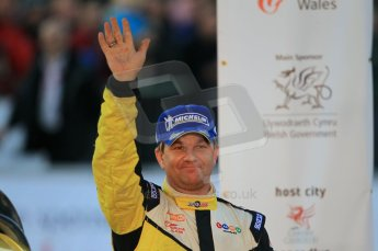 © North One Sport Ltd 2011 / Octane Photographic Ltd 2011. 13th November 2011 Wales Rally GB, Podium. Henning Solberg waves to the crowd from the podium. Digital Ref : 0201cb1d9928