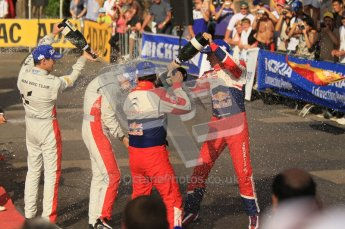 © North One Sport Ltd.2011/Octane Photographic Ltd. WRC Germany – Final Podium - Sunday 21st August 2011. Sebastien Ogier, Julien Ingrassia and Daniel Sordo soak Carlos Corral in champaign. Digital Ref : 0153CB1D6471
