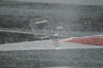 World © Octane Photographic 2011.  Formula 1 testing Saturday 12th March 2011 Circuit de Catalunya. Heavy rain on the pitlane entry. Digital ref : 0018CB1D4360