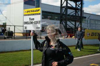 © Octane Photographic Ltd. BTCC - Round Two - Donington Park - Race 1. Sunday 15th April 2012. Tom Onslow-Cole's grid girl awaiting his arrival on the grid. Digital ref : 0295lw1d7654