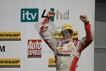 © Octane Photographic Ltd. BTCC - Round Two - Donington Park - Race 1. Sunday 15th April 2012. Matt Neal cheers with the crowd as he enteres the podium. Digital ref : 0295lw7d4131