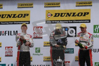 © Octane Photographic Ltd. BTCC - Round Two - Donington Park - Race 1. Sunday 15th April 2012. Mat Jackson, Matt Neal and Gordon Shedden spray the podium champagne. Digital ref : 0295lw7d4230