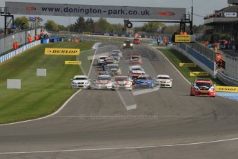 © Octane Photographic Ltd. BTCC - Round Two - Donington Park - Race 2. Sunday 15th April 2012. Tom Onslow-Cole puts 2 wheels on the grass in his eBay motors BMW 320si as race 2 gets underway. Digital ref : 0296lw7d4374