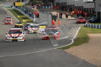 © Octane Photographic Ltd. BTCC - Round Two - Donington Park - Race 2. Sunday 15th April 2012. Gordon Shedden takes a defensive line into Redgate with Mat Jackson looking for a way past. Digital ref : 0296lw7d4571