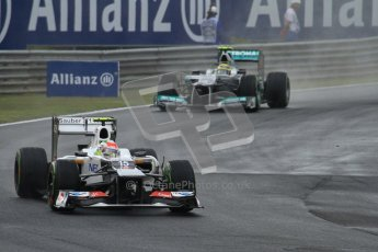 © 2012 Octane Photographic Ltd. Hungarian GP Hungaroring - Friday 27th July 2012 - F1 Practice 2. Sauber C31 - Sergio Perez and Mercedes W03 - Nico Rosberg. Digital Ref : 0426lw7d0084
