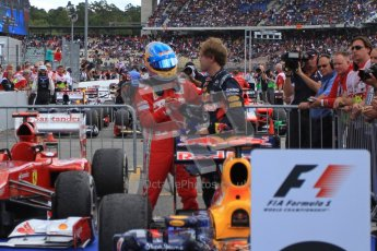 © 2012 Octane Photographic Ltd. German GP Hockenheim - Sunday 22nd July 2012 - F1 Podium - Fernando Alonso (Ferrari) chats with Sebastian Vettel (Red Bull) after climbing out his car. . Digital Ref : 0421lw7d6448