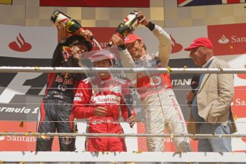 © 2012 Octane Photographic Ltd. German GP Hockenheim - Sunday 22nd July 2012 - F1 Podium - Fernando Alonso - Winner (Ferrari) being showered in champaign by Sebastian Vettel, 2nd (Red Bull), and Jenson Button 3rd. Vettel was later dropped to 5th with a penalty for overtaking Button (McLaren) off the track in the final laps. Digital Ref : 0421lw7d9466