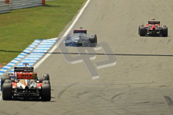 © 2012 Octane Photographic Ltd. German GP Hockenheim - Sunday 22nd July 2012 - F1 Race. McLaren MP4/27 - Lewis Hamilton with a shredded rear left is passed by Charles Pic's Marussia (who sensibly gives him a wide berth) as the battling Glock and Karthikeyan close in as well. Digital Ref : 0423lw1d4984