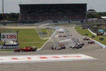 © 2012 Octane Photographic Ltd. German GP Hockenheim - Sunday 22nd July 2012 - F1 Race. Ferrari F2012 - Fernando Alonso leads the pack on the opening lap - as Sebastian Vettel slides up the inside of Michael Schumacher under braking. Digital Ref : 0423lw7d8559