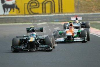 © 2012 Octane Photographic Ltd. Hungarian GP Hungaroring - Sunday 29th July 2012 - F1 Race. Caterham CT01 - Vitaly Petrov and Force India VJM05 - Nico Hulkenberg. Digital Ref :