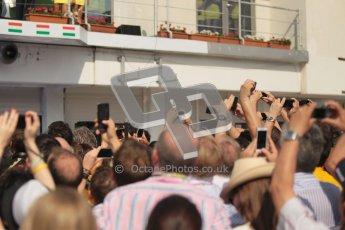 © 2012 Octane Photographic Ltd. Hungarian GP Hungaroring - Sunday 29th July 2012 - F1 Podium. Jubilant team members grabbing their share of the podium celebrations. Digital Ref :