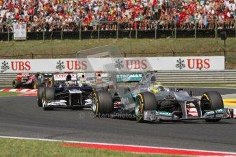 © 2012 Octane Photographic Ltd. Hungarian GP Hungaroring - Sunday 29th July 2012 - F1 Race. Mercedes W03 - Michael Schumacher and Williams FW34 - Pastor Maldonado. Digital Ref :