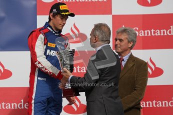 © 2012 Octane Photographic Ltd. British GP Silverstone - Saturday 7th July 2012 - GP2 Race 1 - iSport International - Jolyon Palmer receives his 3rd place trophy. Digital Ref : 0400lw7d6707
