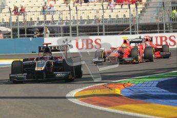 © 2012 Octane Photographic Ltd. European GP Valencia - Sunday 24th June 2012 - GP2 Race 2 - Lotus GP - James Calado heads Rio Haryanto's Carlin. Digital Ref : 0375lw1d6053
