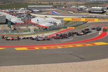 World © Octane Photographic Ltd. F1 USA GP, Austin, Texas, Circuit of the Americas (COTA), Sunday 17th November 2013 - Race. The pack safely heads around turn 1. Digital Ref : 0861lw1d5920