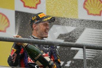 World © Octane Photographic Ltd. F1 Belgian GP - Spa-Francorchamps, Sunday 25th August 2013 - Podium. Infiniti Red Bull Racing RB9 - race winner Sebastian Vettel. Digital Ref : 0798lw1d0793