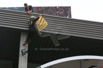 "World © Octane Photographic Ltd. F1 Belgian GP - Spa-Francorchamps, Sunday 25th August 2013 - Podium. Anti Shell Arctic drill activists Greenpeace ""Savethearctic.org"" protesting on podium. Digital Ref : 0798lw1d0895"