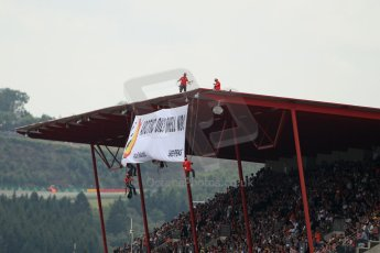"World © Octane Photographic Ltd. F1 Belgian GP - Spa-Francorchamps, Sunday 25th August 2013 - Podium. Anti Shell Arctic drill activists Greenpeace ""Savethearctic.org"" protesting during the race from the main straight grandstand. Digital Ref :"