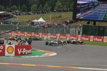 World © Octane Photographic Ltd. F1 Belgian GP - Spa-Francorchamps, Sunday 25th August 2013 - Race. Mercedes AMG Petronas F1 W04 – Lewis Hamilton leads the pack into turn 1. Digital Ref : 0797lw1d0697