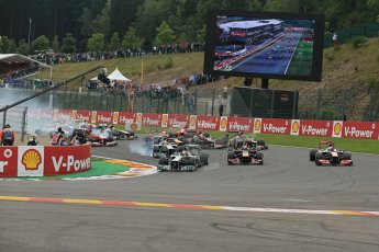 World © Octane Photographic Ltd. F1 Belgian GP - Spa-Francorchamps, Sunday 25th August 2013 - Race. Mercedes AMG Petronas F1 W04 – Lewis Hamilton leads the pack into turn 1. Digital Ref : 0797lw1d0705
