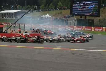 World © Octane Photographic Ltd. F1 Belgian GP - Spa-Francorchamps, Sunday 25th August 2013 - Race. The pack safely clears turn 1 on the opening lap. Digital Ref : 0797lw1d0722