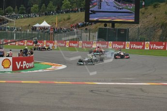 World © Octane Photographic Ltd. F1 Belgian GP - Spa-Francorchamps, Sunday 25th August 2013 - Race. Mercedes AMG Petronas F1 W04 - Nico Rosberg dives into La Source ahead of Jenson Button (Vodafone McLaren Mercedes) and Fernando Alonso (Scuderia Ferrari). Digital Ref : 0797lw1d0769