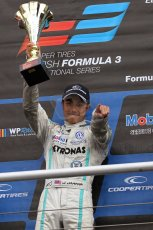 World © Octane Photographic Ltd. British Formula 3 – Brands Hatch. Saturday 10th August 2013 – Race 1. Race winner Jazeman Jaafar celebrates on the International Class podium – Carlin – Dallara F312 Volkswagen. Digital Ref : 0777lw7d1250