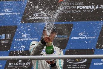 World © Octane Photographic Ltd. British Formula 3 – Brands Hatch. Saturday 10th August 2013 – Race 1. Race winner Jazeman Jaafar celebrates on the International Class podium – Carlin – Dallara F312 Volkswagen. Digital Ref : 0777lw7d1282