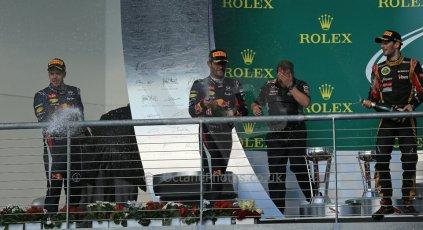 World © Octane Photographic Ltd. F1 USA GP, Austin, Texas, Circuit of the Americas (COTA), Sunday 17th November 2013 - Podium. Infiniti Red Bull Racing - Sebastian Vettel (1st), Lotus F1 Team - Romain Grosjean (2nd) and Infiniti Red Bull Racing - Mark Webber (3rd). Digital Ref : 0862lw1d6409