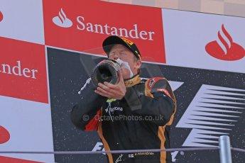 World © 2013 Octane Photographic Ltd. F1 Spanish GP, Circuit de Catalunya - Sunday 12th May 2013 - Race. Lotus F1 Team - Kimi Raikkonen takes a good taste of his podium champagne. Digital Ref : 0674cb1d3021