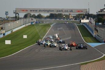 World © Octane Photographic Ltd. BRDC Formula 4 (F4) Race 1, Donington Park 28th September 2013. MSVF4-13, Lanan Racing, Jake Hughes leads the pack as the race starts as James Greenway's nose bodywork goes flying. Digital Ref : 0833lw1d9221