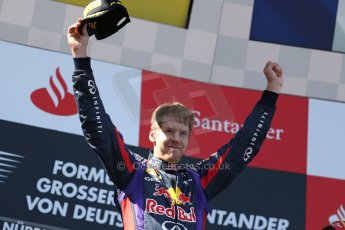 World © Octane Photographic Ltd. F1 German GP - Nurburgring. Sunday 7th July 2013 - Podium. Infiniti Red Bull Racing - Race Winner Sebastian Vettel. Digital Ref : 0750au8i0381