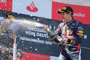 World © Octane Photographic Ltd. F1 German GP - Nurburgring. Sunday 7th July 2013 - Podium. Infiniti Red Bull Racing - Race Winner Sebastian Vettel celebrates. Digital Ref : 0750au8i0497
