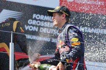 World © Octane Photographic Ltd. F1 German GP - Nurburgring. Sunday 7th July 2013 - Podium. Infiniti Red Bull Racing - Race Winner Sebastian Vettel celebrates. Digital Ref : 0750au8i0505