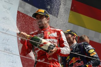 World © Octane Photographic Ltd. F1 British GP - Silverstone, Sunday 30th June 2013 - Race. Scuderia Ferrari F138 - Fernando Alonso sprays his champagne from the podium. Digital Ref : 0734lw1d2908