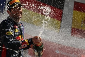 World © Octane Photographic Ltd. F1 British GP - Silverstone, Sunday 30th June 2013 - Race. Infiniti Red Bull Racing RB9 - Mark Webber sprays his champagne from the podium. Digital Ref : 0734lw1d2926