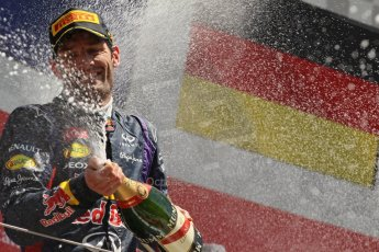 World © Octane Photographic Ltd. F1 British GP - Silverstone, Sunday 30th June 2013 - Race. Infiniti Red Bull Racing RB9 - Mark Webber sprays his champagne from the podium. Digital Ref : 0734lw1d2928