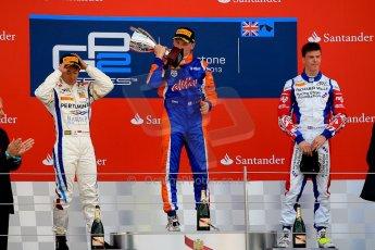 World © Octane Photographic Ltd./Chris Enion. GP2 British GP, Silverstone, Sunday 30th June 2013. Race 2 winner Jon Lancaster - Hilmer Motorsport celebrates on the podium with James Calado and Rio Haryanto. Digital Ref : 0732ce1d9582