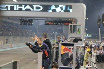 World © Octane Photographic Ltd. Sunday 23rd November 2014. Abu Dhabi Grand Prix - Yas Marina Circuit - Formula 1 Podium. Infiniti Red Bull Racing welcome their team across the line. Digital Ref: 1173CB1D0141