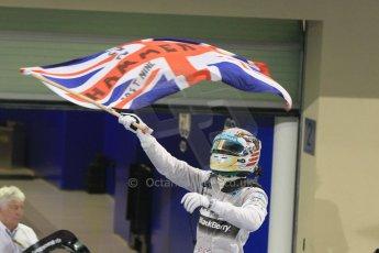 World © Octane Photographic Ltd. Sunday 23rd November 2014. Abu Dhabi Grand Prix - Yas Marina Circuit - Formula 1 Podium. Mercedes AMG Petronas – Lewis Hamilton - Race winner and 2014 World Champion. Digital Ref: 1173CB1D0418