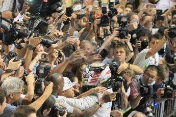 World © Octane Photographic Ltd. Sunday 23rd November 2014. Abu Dhabi Grand Prix - Yas Marina Circuit - Formula 1 Podium. Mercedes AMG Petronas – Lewis Hamilton - Race winner and 2014 World Champion greeting his team and family. Digital Ref: 1173CB1D0464