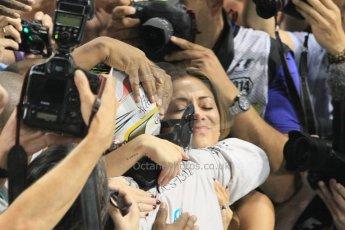 World © Octane Photographic Ltd. Sunday 23rd November 2014. Abu Dhabi Grand Prix - Yas Marina Circuit - Formula 1 Podium. Mercedes AMG Petronas – Lewis Hamilton - Race winner and 2014 World Champion and Nicole Scherzinger. Digital Ref: 1173CB1D0478